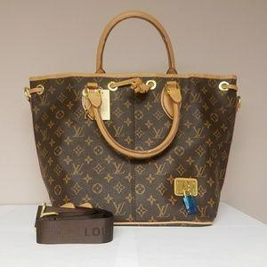 New Louis Vuitton handbag.